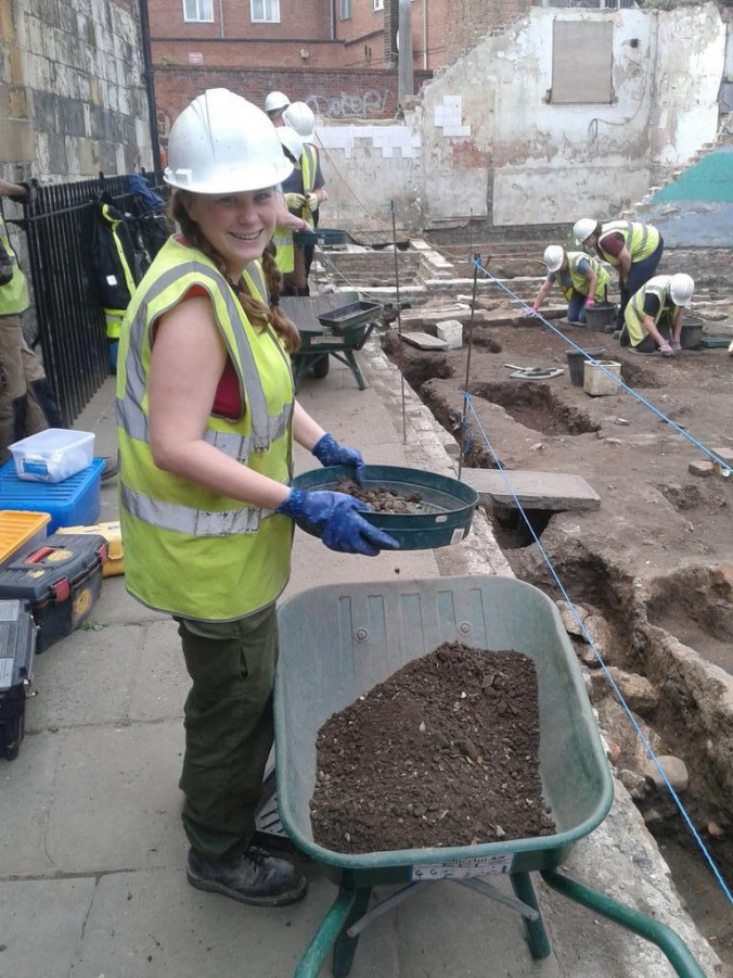 Rosie cheerfully sieving the backfill of the horn pit.