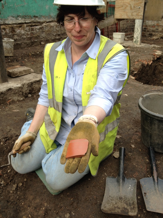 Reinhilde displays her freshly unearthed samian bowl sherd.