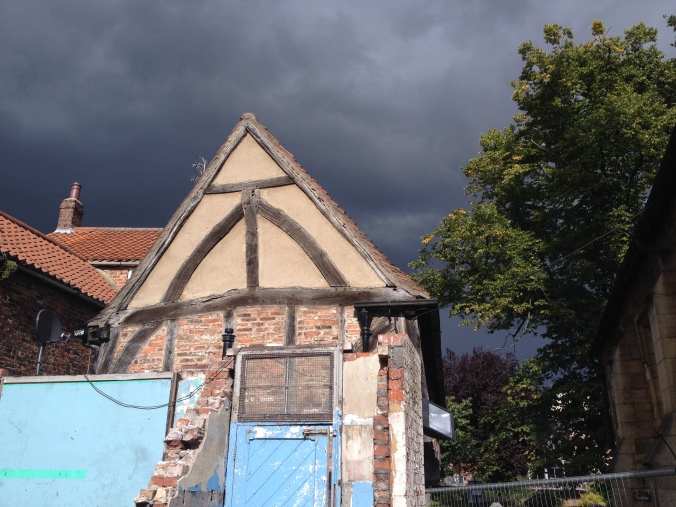 Ominous skies over All Saints Cottages.